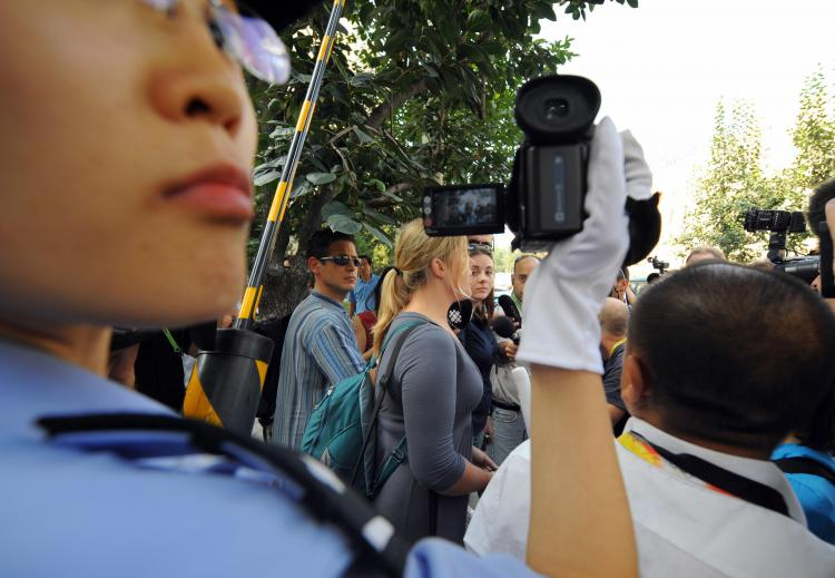 Ginger Cassady (C), a 'Students for a Free Tibet' activist from San Francisco, as she talks to reporters in Beijing on August 22, 2008. (Chai Hin/AFP/Getty Images)