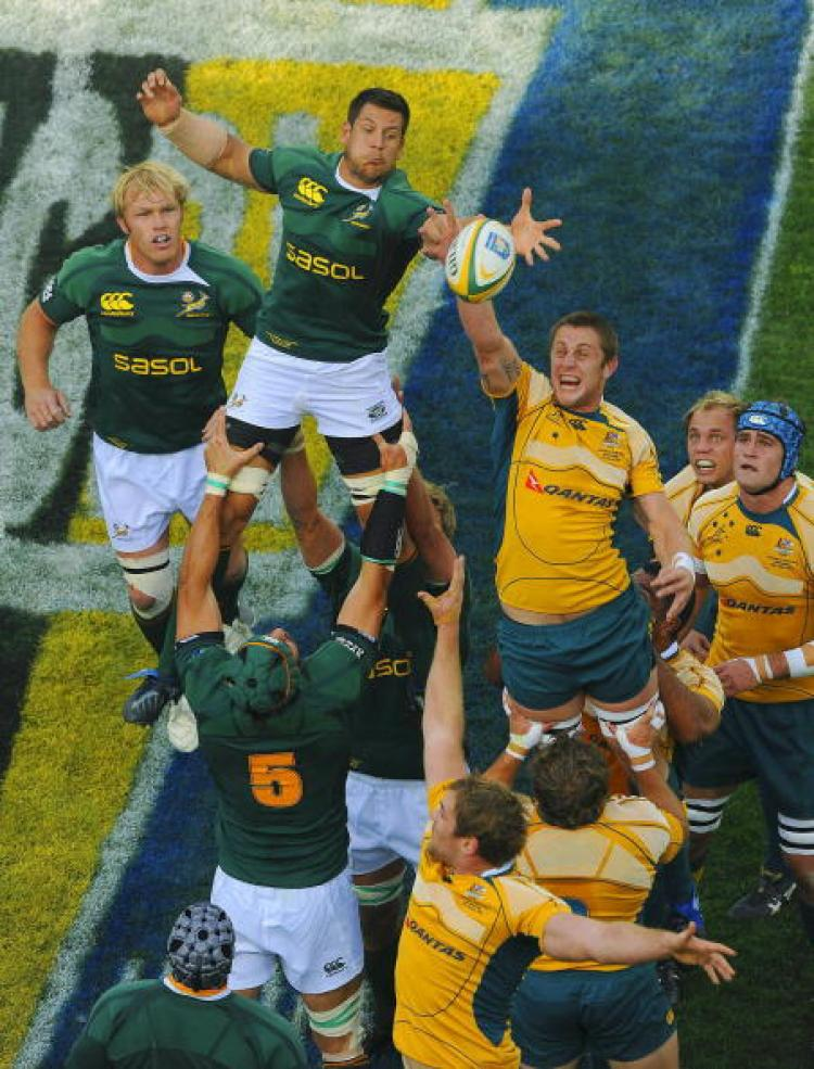 Tough going�Pierre Spies of South Africa and Hugh McMeniman of Australia compete in a line-out during the Tri-Nations match last Saturday in Johannesburg, South Africa. (Duif du Toit/Gallo Images/Getty Images )