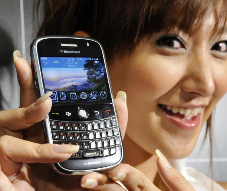 A model displays Canadian electronics maker Research In Motion's BlackBerry Bold smart phone in Tokyo. The new BlackBerry which can use high-speed 3G and IEEEa/b/g wireless LAN network will be launched in Japan early 2009.  (YOSHIKAZU TSUNO/AFP/Getty Images)