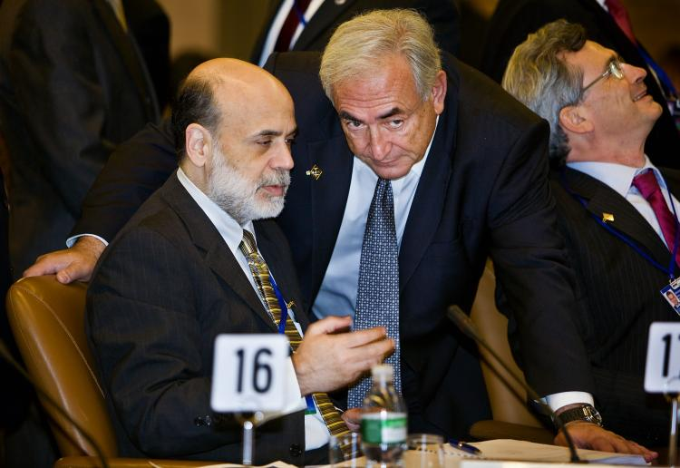 Federal Reserve Chairman Ben Bernanke speaks with Managing Director of IMF, Dominique Strauss before an IMF committee meeting where the hot topic was the world economy. (Stephen Jaffe/IMF via Getty Images)