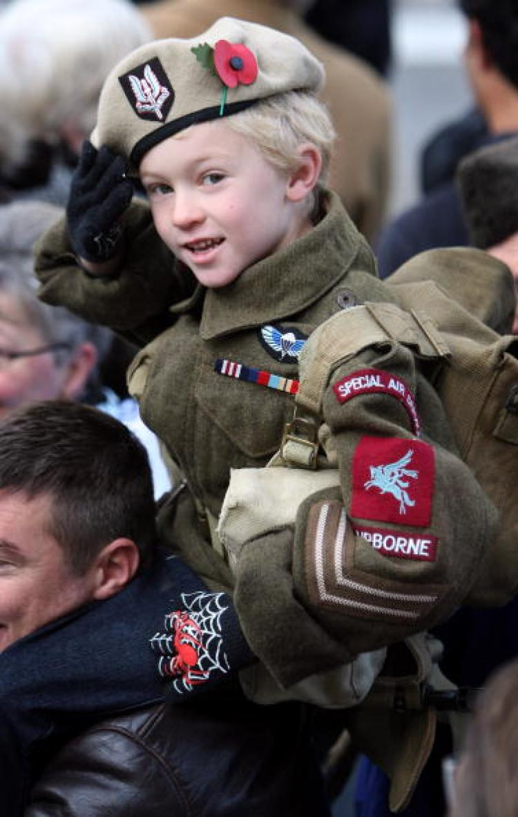 Alfie Amos, 6, wears a World War II SAS uniform as he salutes at the Remembrance Sunday Service at the Cenotaph on November 9, 2008 in London. (Chris Jackson/Getty Images)