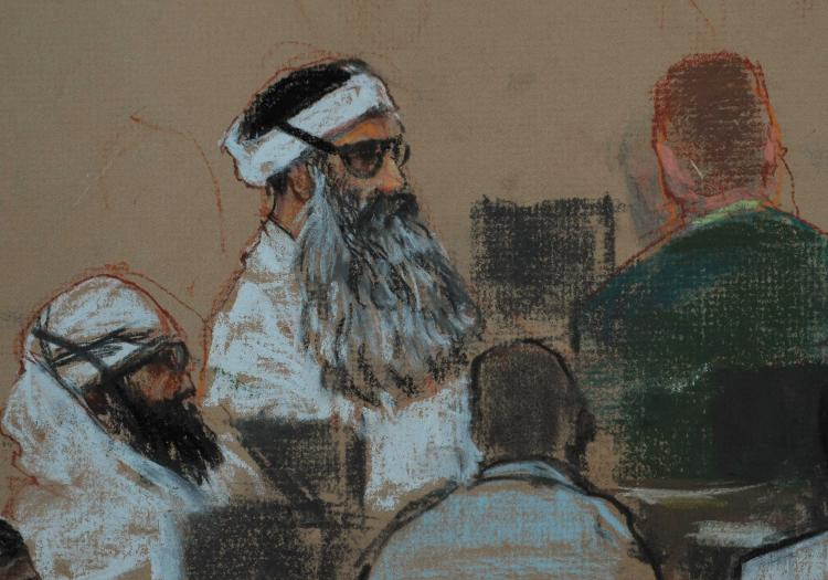 An image of a courtroom shows Khalid Sheikh Mohammed (C) and co-defendant Walid Bin Attash (L) attending a pre-trial session December 8, 2008 in Guantanamo Bay, Cuba. (Sketch by Janet Hamlin-Pool/Getty Images)