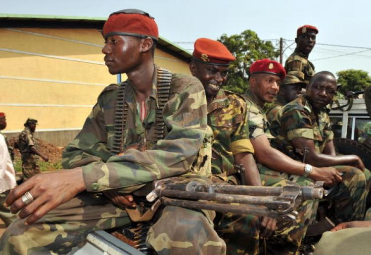 Armed military personnel of the junta are seen in Guinea on December 25, 2008. (SEYLLOU/AFP/Getty Images )