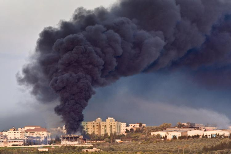 Smoke billows from the Gaza Strip following an air strike by the Israeli airforce on Hamas enclaves. (Yoav Lemmer/AFP/Getty Images)
