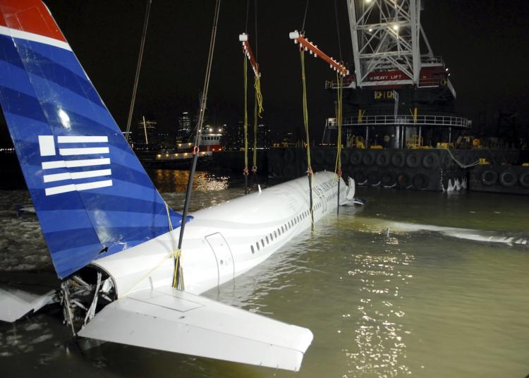 US Airways flight 1549 known as the 'the Miracle on the Hudson,' being removed from its makeshift mooring along a seawall in lower Manhattan January 17, 2009. The plane will now find a home as a tourist attraction at the Carolinas Aviation Museum. (Edouard H.R. Gluck-Pool)