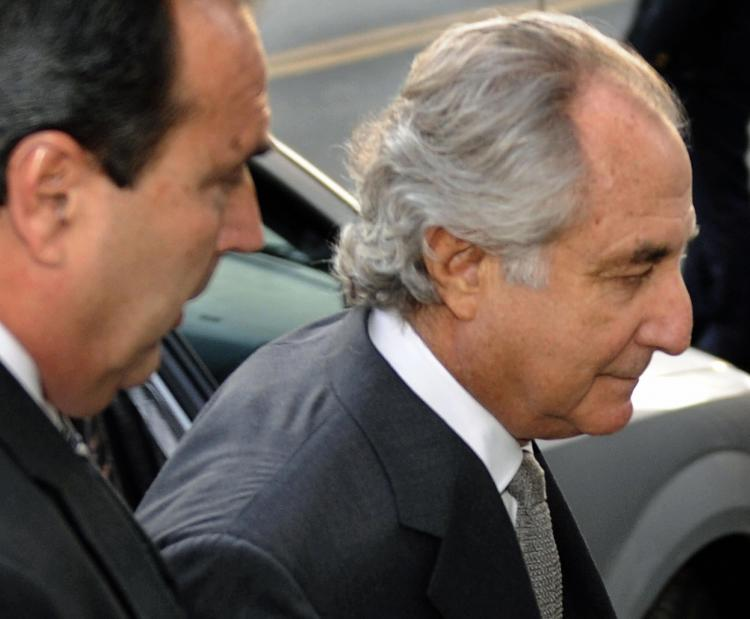 Bernie Madoff, the biggest fraudster of them all, arrives at a US Federal Court in March 12 in New York. Economic crime in Canada rose to its highest in six years in 2009. (Timothy A. Clary/AFP/Getty Images)