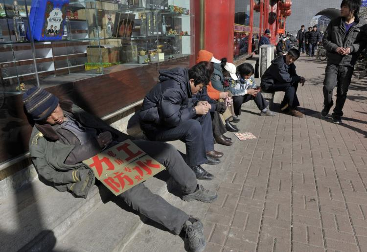Migrant workers look for job opportunities along a roadside in Shenyang, Liaoning Province, China.  (China Photos/Getty Images)