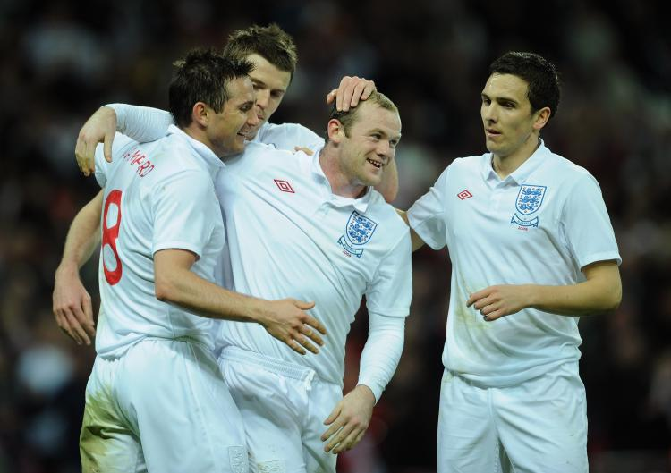 ROAD TO WORLD CUP: Wayne Rooney celebrates with his team mates after he scored during the International Friendly match between England and Slovakia at Wembley Stadium on March 28 (Shaun Botterill/Getty Images)