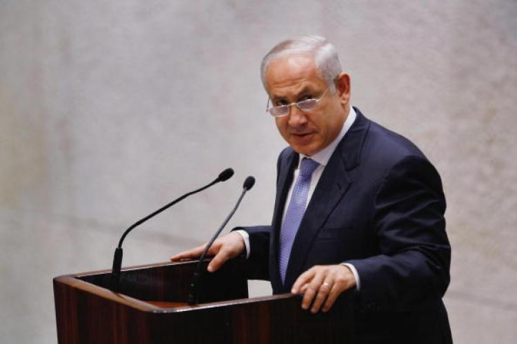 Israeli Prime Minister-Designate Benjamin Netanyahu said he was willing to talk peace with the Palestinians as he presented his cabinet for parliamentary approval amid international concern Israel's new government could bury the negotiations. (David Silverman/AFP/Getty Images)