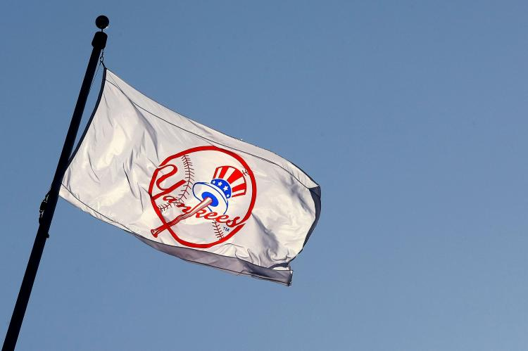 A Yankee flag waves over new New York Yankees stadium. (Chris McGrath/Getty Images)