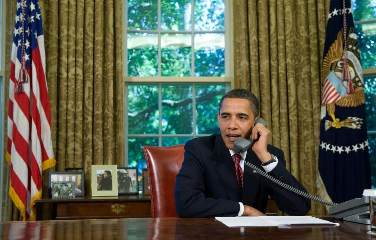 Landlines becoming outdated? US President Barack Obama talks on the phone with Astronauts aboard the Space Shuttle Atlantis, while on a mission to repair the Hubble Space Telescope, from the White House in Washington, May 20, 2009. (Saul Loeb/AFP/Getty Images)