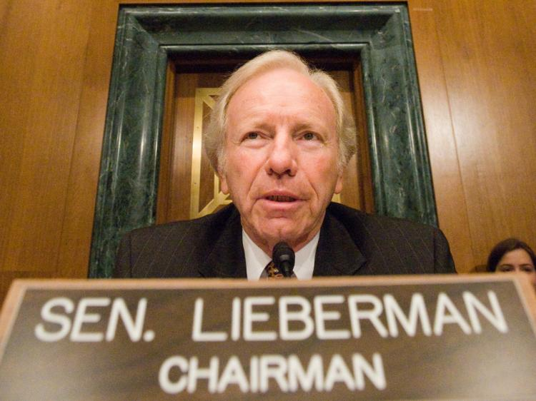 Sen. Lieberman said companies double-dipping would have to be given a choice to do business with one or the other, but not both. (Kris Connor/Getty Images)