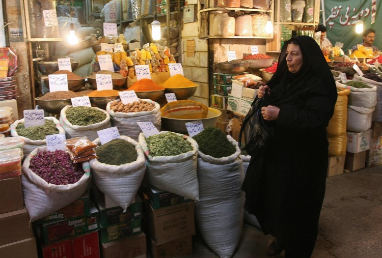 An Iranian woman shops at a bazaar