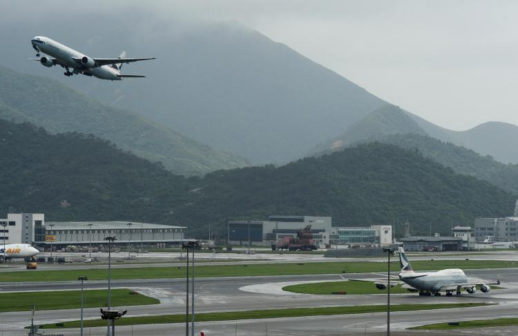 A Cathay Pacific aircraft takes off from Hong Kong's international airport.  (Ed Jones/AFP/Getty Images)