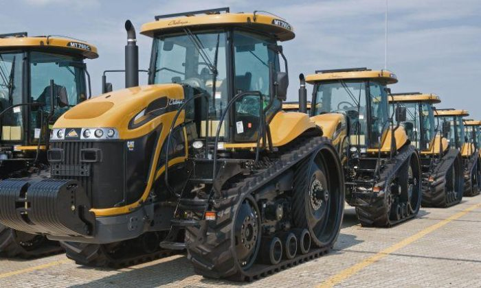 FOR EXPORT: Rows of the Caterpillar Challenger MT765C farm tractors, ideally suited to row-crop work, sit on on the docks of the Port of Baltimore's Dundalk Terminal on Aug. 27, 2009, waiting to be loaded for export by ship, in Baltimore, Md. (Paul J. Richards/AFP/Getty Images)