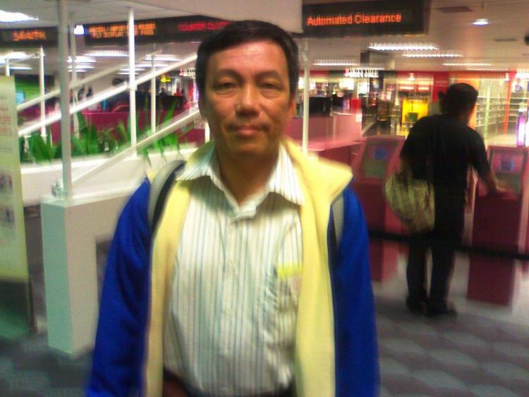 Liman, from Indonesia, stands at the airport in a photo taken with his cell phone. He was turned away by officials at the Singapore airport who did not explain why. (Courtesy of subject)