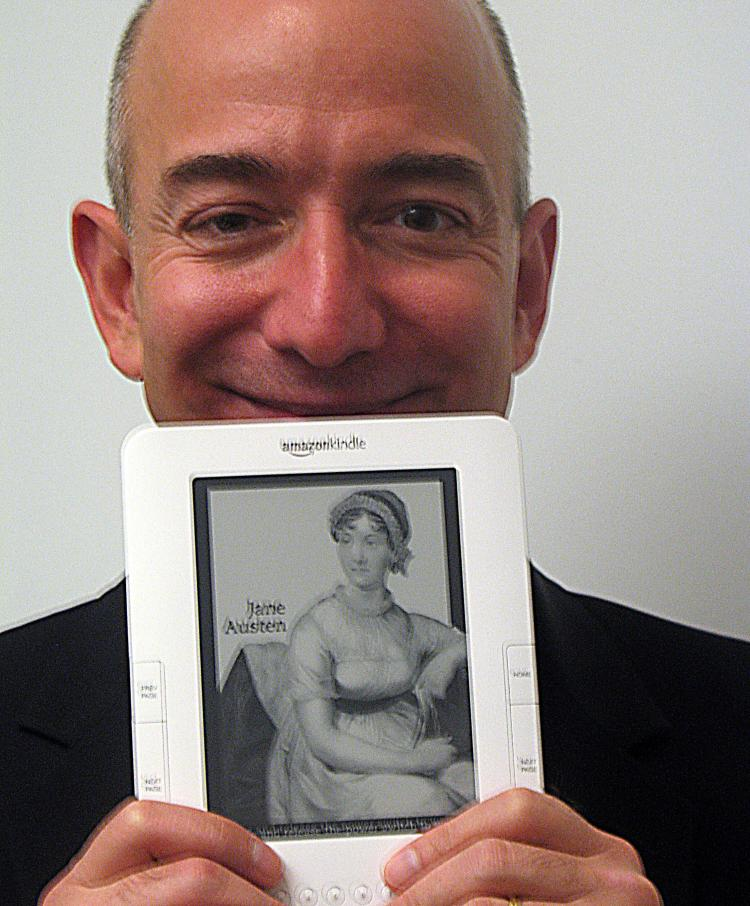 Amazon.com founder and chief executive Jeff Bezos holds an international Kindle electronic book reader, designed to make digital works easy to download wirelessly in countries around the world. (Glenn Champman/AFP/Getty Images)
