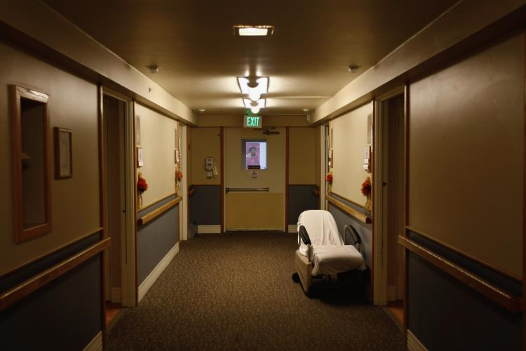 A mobile recliner sits outside the room of a terminally ill resident of the Hospice of Saint John on November 5, 2009 in Lakewood, Colorado. The non-profit hospice accepts patients regardless of their ability to pay, although most are covered by Medicare and Medicaid. (John Moore/Getty Images)