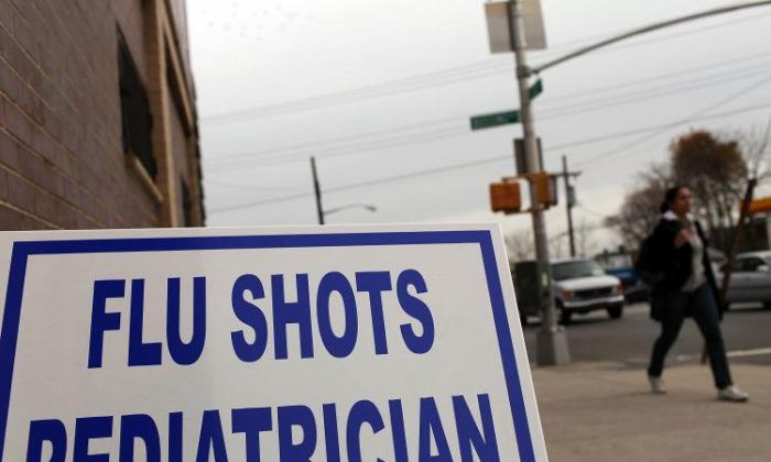 A medical center advertises for flu shots in New York City.  (Spencer Platt/Getty Images)