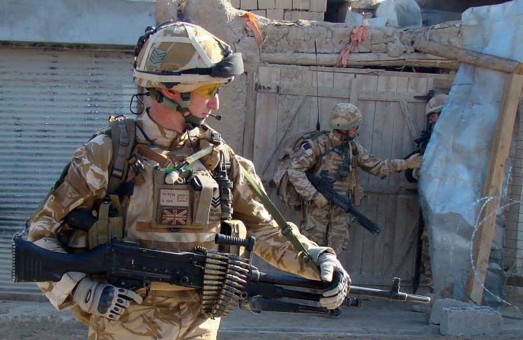 British soldiers with the NATO-led International Security Assistance Force (ISAF) patrol in Sangin district of Helmand province on December 2, 2009. (ABDUL MALIK/AFP/Getty Images)