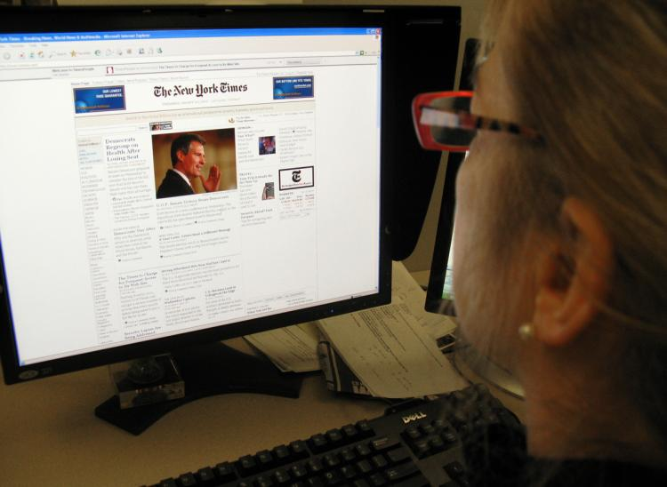 When the New York Times started to charge for online news content, overall website visits decreased by up to 15 percent. A new study says 81 percent of Canadians would not pay to read news online. (Karen Bleier/Getty images)