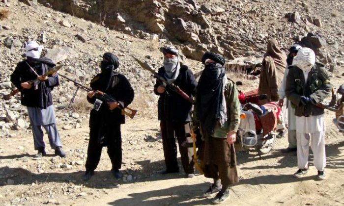 Taliban fighters stand alert during a patrol in Ghazni Province, Afghanistan, on Jan. 23, 2010. (STR/Getty Images)