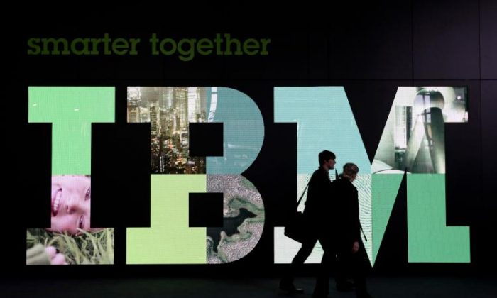 Visitors walk past the IBM logo at the CeBIT Technology Fair on March 3,in Hannover, Germany. IBM scientists are making a 3-D map of the Earth so small that 1,000 of them could fit on a grain of salt. (Sean Gallup/Getty Images)