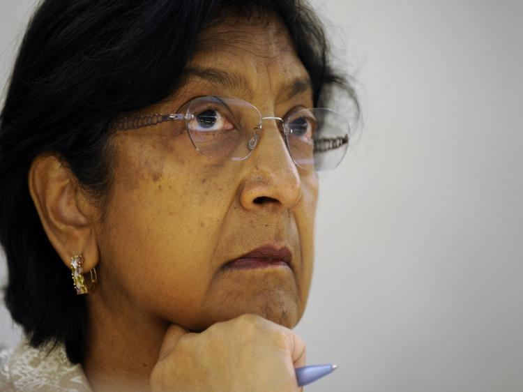 UN High Commissioner for Human Rights Navi Pillay attends at the UN office in Geneva on March 22, 2010 a Human Rights Council session to debate a report by former international war crimes prosecutor Richard Goldstone on the 22-day Gaza war Israel launched (Fabrice Coffrini/AFP/Getty Images)