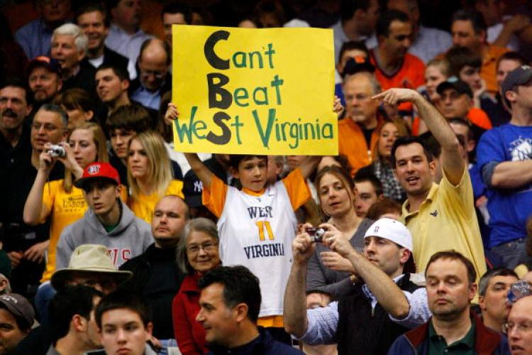 A fan of the WV Mountaineers holds up a sign in reference to the game being broadcast on CBS network against the Kentucky Wildcats.  (Chris Chambers/Getty Images)