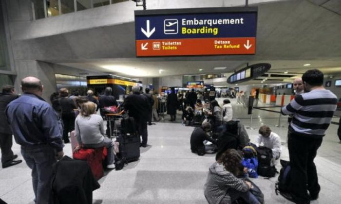People wait on April 15, 2010 at the Charles-de-Gaulle airport in Roissy, outside Paris, in a file photo. (Mehdi Fedouach/AFP/Getty Images)