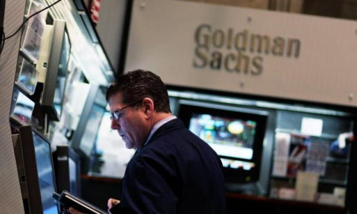 A financial professional works in the Goldman Sachs booth on the floor of the New York Stock Exchange April 16, 2010 in New York City. (Chris Hondros/Getty Images)