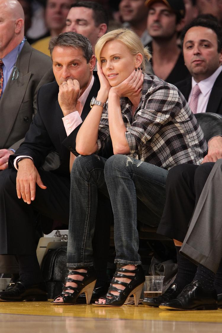 Charlize Theron attends a Lakers game wearing greg Jeggings. (Noel Vasquez/Getty Images)
