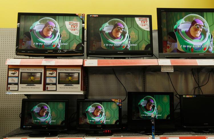 PURSUING STUFF: Flat screen televisions for sale are seen at a retail store April 30 in New York.  (Chris Hondros/Getty Images)