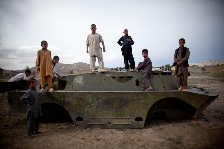 Afghan boys on the outskirts of Kabul play inside a destroyed tank left over from the 1979-1989 Russian invasion on May 2, 2010 in Afghanistan. 'This used to be a battlefield,' said young Ubaydullah, 'but now it's our playground.' The Pashtun people also known as Pathans, primarily live in Afghanistan and Pakistan with a total population estimated at around 42 million in some of the 60 major tribes and sub clans (Majid Saeedi/Getty Images)