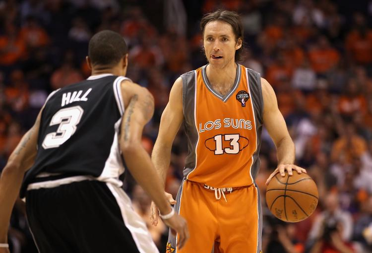 Steve Nash of the Phoenix Suns moves the ball upcourt the 2010 NBA Playoffs on May 5, 2010 in Phoenix, Arizona. The team is wearing 'Los Suns' jerseys on Cinco de Mayo in response to the anti-immigration law recently passed in Arizona. (Christian Petersen/Getty Images)
