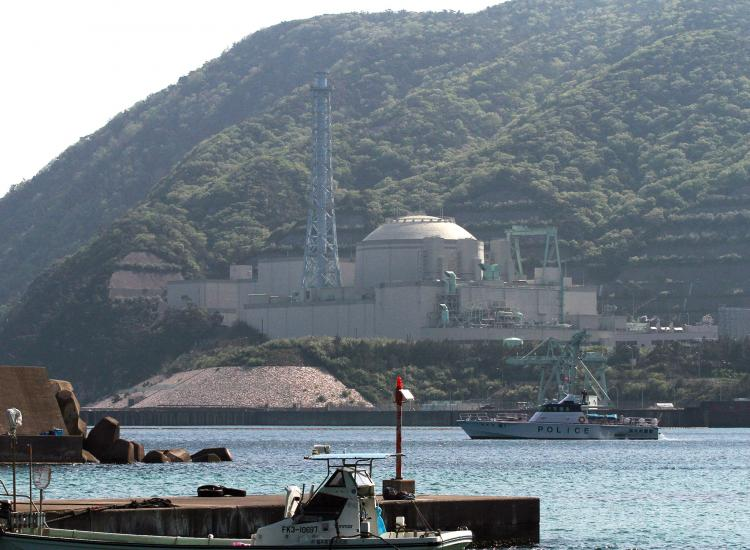 A police boat patrols around the nuclear reactor Monju in Tsuruga, Fukui Prefecture on May 6. (Jiji Press/AFP/Getty Images)
