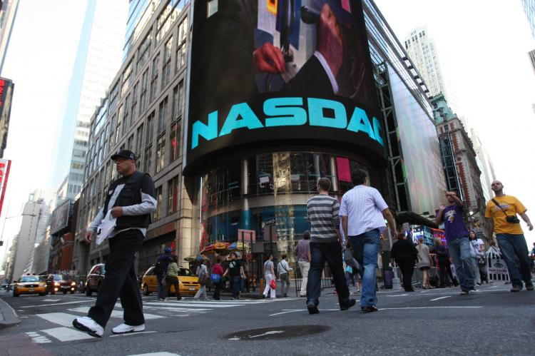 The Nasdaq building in Times Square. The board of NYSE Euronext on Monday rejected the $11.3 billion joint takeover bid from Nasdaq OMX Group and IntercontinentalExchange.  (Daniel Barry/Getty Images )