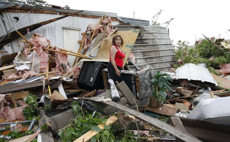 Linda King, 61, stands in the debris of the trailer home she had not yet finished moving into in Slaughterville, Oklahoma, after the Oklahoma tornado. (Brett Deering/Getty Images)