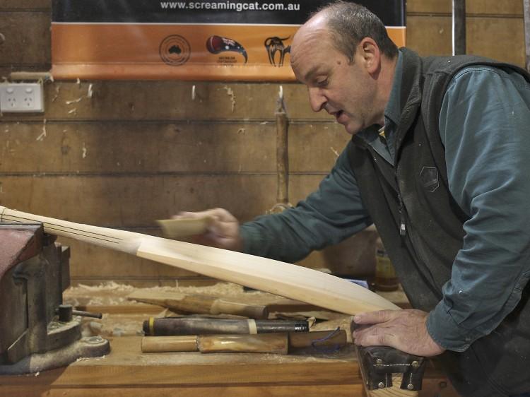 Craftsman Julian Milichamp sands a cricket bat