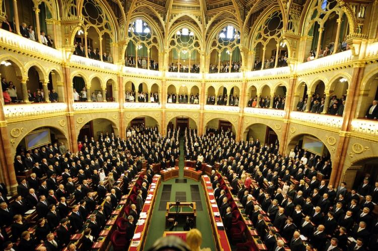 Representatives of the Hungarian Parliament sing the national anthem on May 14, during the re-formation of Hungarian Parliament. A Hungarian nationality law passed on May 26 grants any ethic Hungarian living in any country citizenship.  (Attila Kisbenedek/Getty Images)