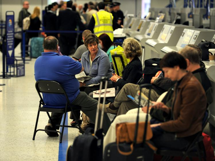 Passengers wait for information at Manchester Airport, in Manchester, after the airport was closed following a further disruption due to volcanic ash on May 16, 2010. Thousands of passengers were being re-routed on buses via other airports or having their flights canceled. (Paul Ellis/AFP/Getty Images)