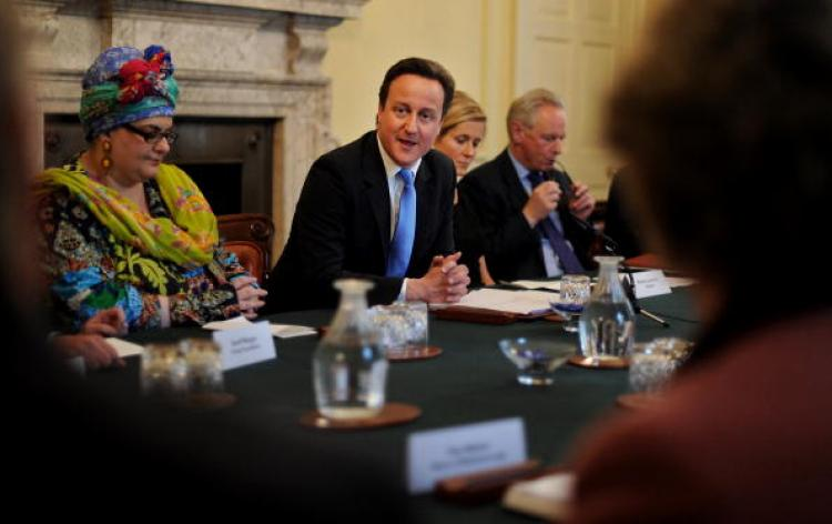Founder of Kids Co, Camila Batmanghelidjh (L), attends the 'the Big Society' meeting, chaired by British Prime Minister, David Cameron, (C), in the cabinet room of 10 Downing Street in central London, on May 18, 2010. (Ben Stansall/AFP/Getty Images))
