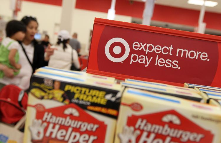 EXPANDING NORTH: A sign is posted next to sales items at a Target last year in Daly City, Cali. Target announced on Thursday that it had purchased 220 Zellers stores in Canada, which it would convert into Target starting in 2013.