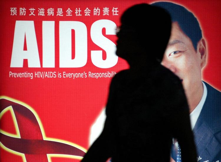 Belgian VRT television reporters preparing an AIDS Day report were threatened, beaten and robbed by local authority's thugs.  (LIU JIN / AFP / Getty Images)