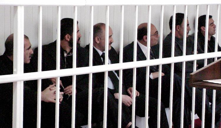 BAKU, AZERBAIJAN: six of seven Azerbaijan opposition leaders during their trial in Baku, on May 7, 2004. International human rights groups condemned the Azerbaijan government over the long-term imprisonment of the prominent journalist Eynulla Fatullayev. (AFP/Getty Images )