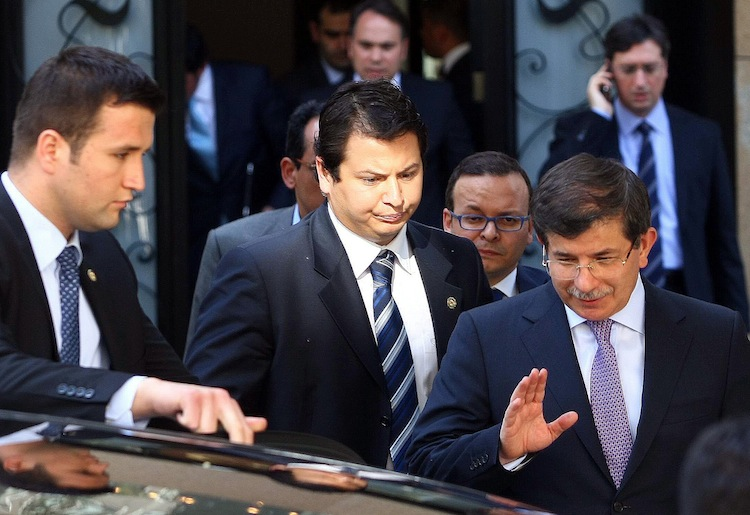Turkey's Foreign Minister Ahmet Davutoglu (R) leaves a meeting about Syria with army generals and other officials in Ankara, June 23. (Adem Altan/AFP/GettyImages)