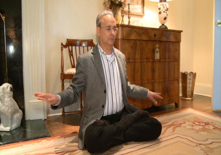 Alan Adler is practicing the sitting meditation. (The Epoch Times)