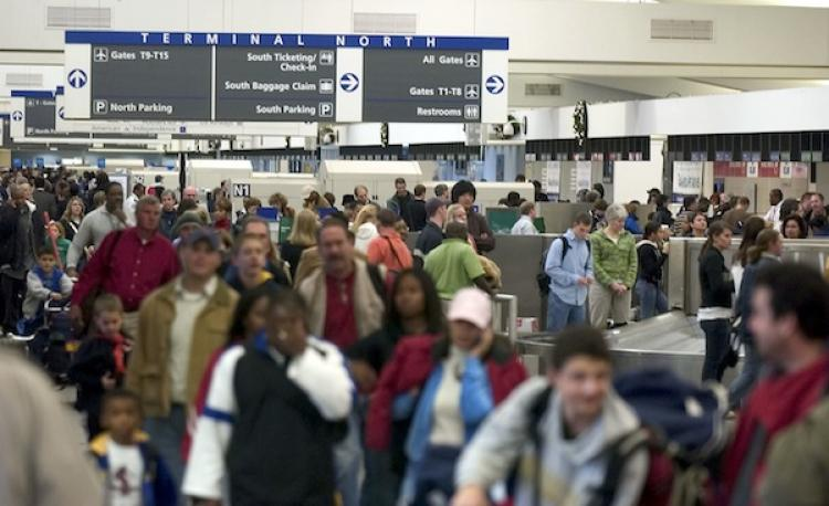 Travelers in Atlanta's Hartsfield-Jackson International Airport in GA. The Federal Aviation Administration (FAA) released a report that predicts in the next 20 years, air travel will more then double from what it is today. (Barry Williams/Getty Images)