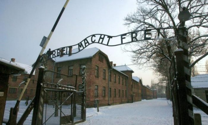 A replica hung in place of the stolen infamous 'Arbeit macht frei' sign at the former Nazi death camp Auschwitz in Oswiecim, Poland, on Dec. 18, 2009. (Jacek Bednarczyk/AFP/Getty Images)