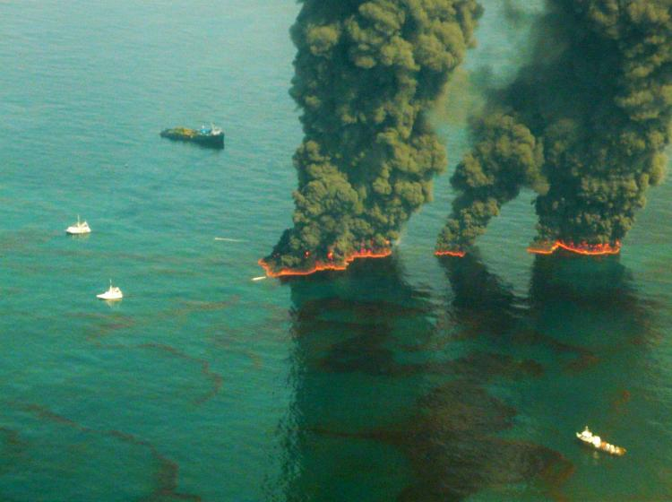 Smoke rises from a controlled burn May 19, in the Gulf of Mexico. Environmental Protection Agency (EPA) has ordered BP to use a less toxic chemical oil dispersant to break up the oil in the Gulf.  (John Kepsimelis/U.S. Coast Guard via Getty Images)
